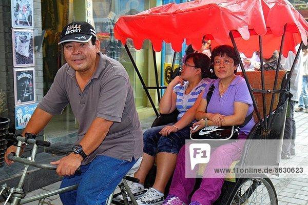 Fahrradrikscha  Frau  Mann  fahren  Geschichte  kaufen  Passagier  Peking  Hauptstadt  China