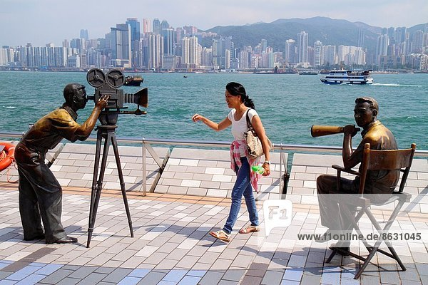 Fischereihafen  Fischerhafen  Frau  Mann  Hochhaus  Insel  Kameramann  China  Hongkong