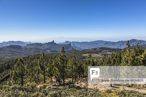 View from Pico de las Nieves towards Roque Nublo Mountain  Teide Mountain on the island of Tenerife at the rear  Gran Canaria  Canary Islands  Spain
