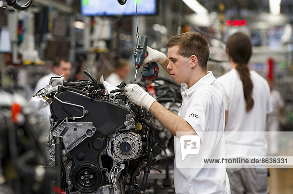 Man working on the production line of the Audi A3 at the Audi plant  Ingolstadt  Bavaria  Germany