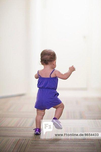 Toddler girl learning to walk