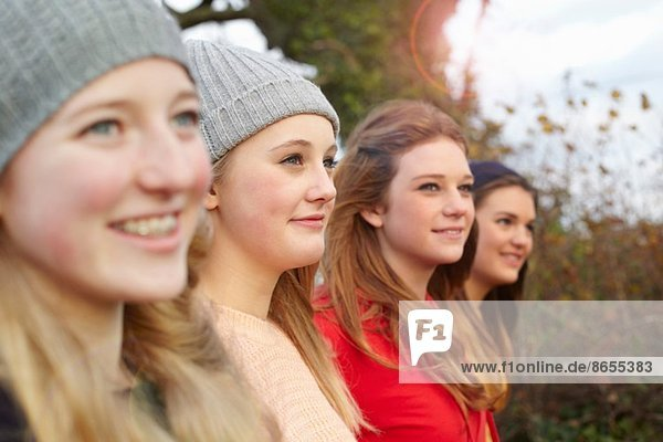 Close up of four teenage girls outdoors