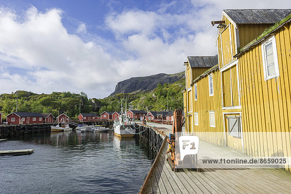 Warehouse and Rorbuer fishermen's cabins in the port of Nusfjord  Lofoten  Nordland  Norway