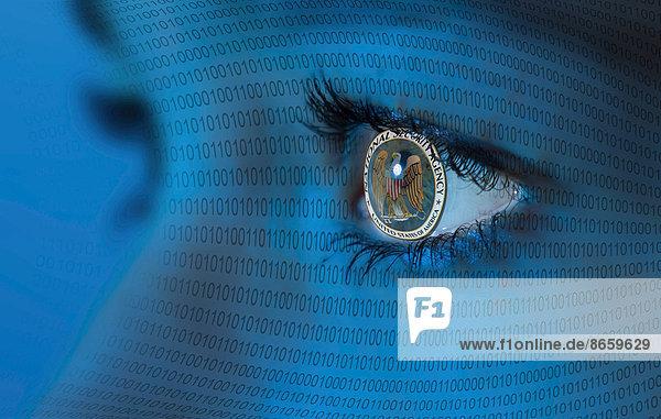 NSA logo in a woman's eye and binary code