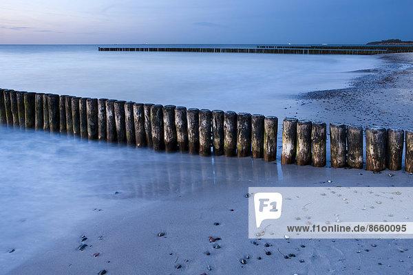 Groynes in the evening  coast at  Nienhagen  Mecklenburg-Western Pomerania  Germany