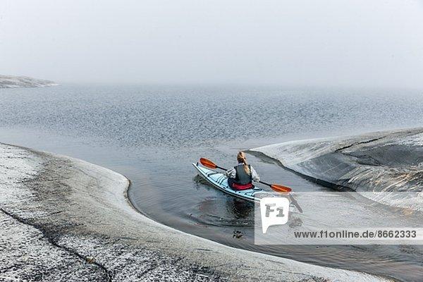 Woman canoeing  Sweden