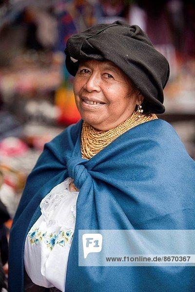 Elderly indigenous vendor of Otavalo market  Otavalo  Quito Area  Imbabura Province  Ecuador  South America.