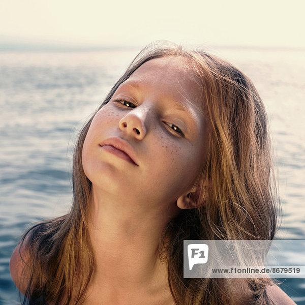 Caucasian girl standing on beach
