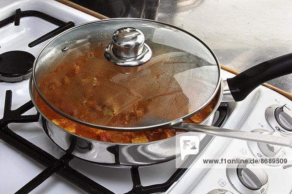 kochen  Huhn  Gallus gallus domesticus  Pfanne
