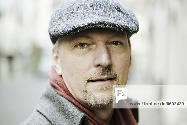 Portrait of man with cap