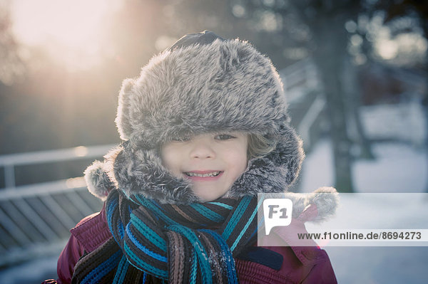 Smiling boy outdoors in winter  portrait