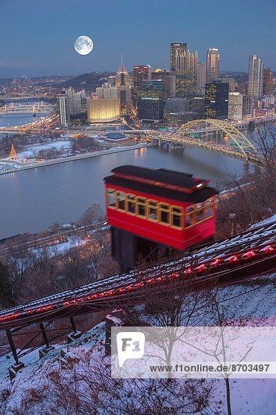 CHRISTMAS LIGHTS DUQUESNE INCLINE RED CABLE CAR MOUNT WASHINGTON PITTSBURGH SKYLINE PENNSYLVANIA USA.