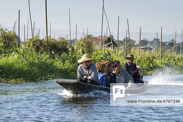 People in a canoe  floating garden  field on the water  Inle Lake  Shan State  Myanmar