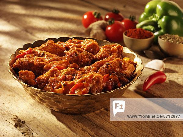 Curry Currypulver Essgeschirr Huhn Gallus gallus domesticus Sonnenlicht Currygericht Curry