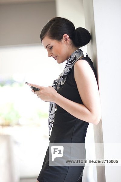 Young businesswoman texting on her smartphone