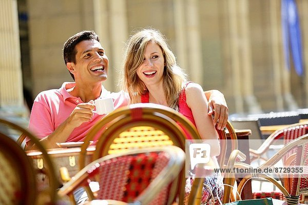 Couple drinking coffee on a terrace. San Sebastian. Donostia. Gipuzkoa. Basque Country. Spain.