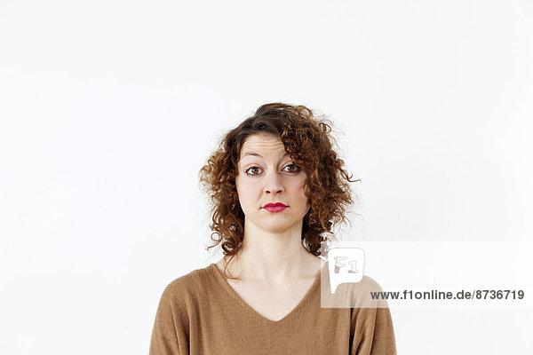 Junge Frau mit fragenden Gesichtsausdruck