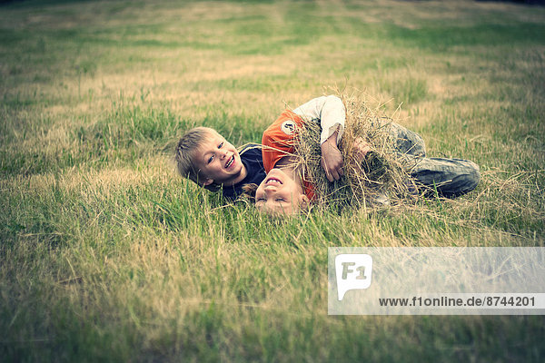 Boy and girl rampaging on a meadow