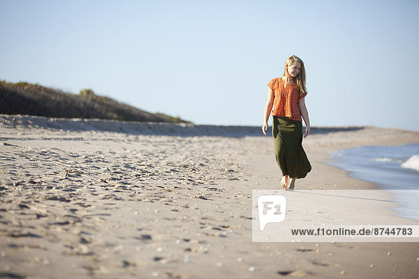 Young Woman Enjoying Walk on Beach  Palm Beach Gardens  Palm Beach County  Florida  USA