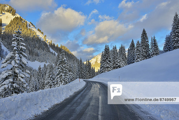 Road in Winter with Snow Covered Mountains  Berwang  Alps  Tyrol  Austria