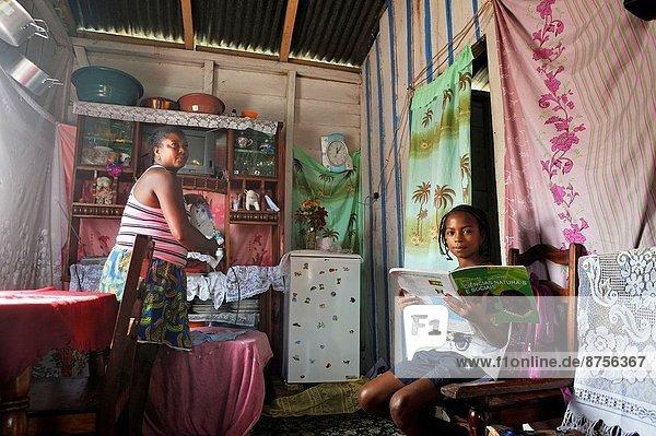 Bügeleisen Jugendlicher Buch Insel jung Mutter - Mensch Afrika Hausaufgabe