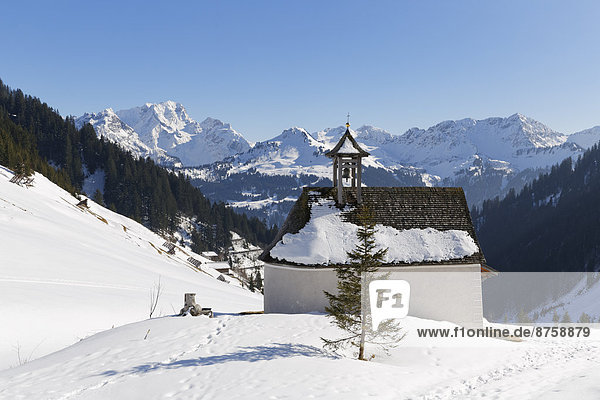 Alps architecture Austria blue sky building chapel church daytime Faschina Großes Walsertal high mountain range landscape mountain landscape mountains mountains nature nobody outdoors religious building snow snowy travel photography Vorarlberg winter winter landscape