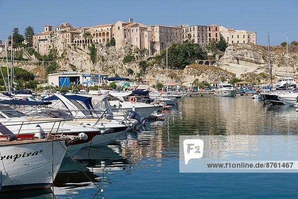 The view of Tropea town sitting on the cliffs from Tropea Marina  Porto di Tropea  Tropea  Vibo Valentia  Calabria  Southern Italy  Italy.