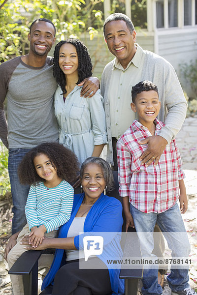 Portrait of smiling multi-generation family outdoors