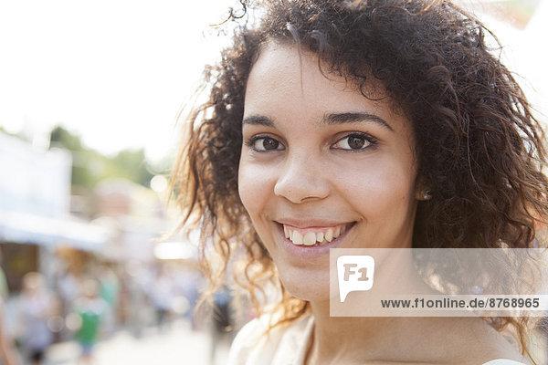 Young woman at fairground  portrait