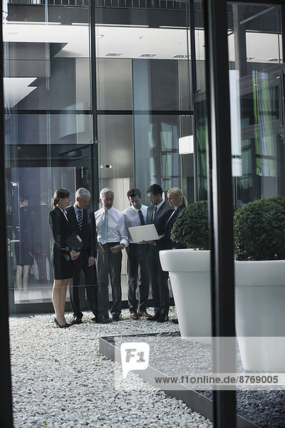 Group of businesspeople with laptop