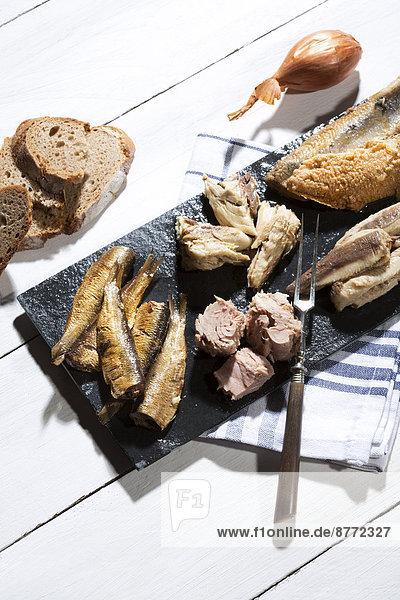 Variety of pickled and marinated fish