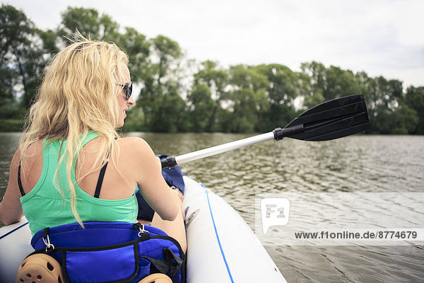 Blond woman with boat on River Main