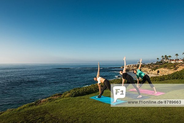 Women on cliff  in yoga position