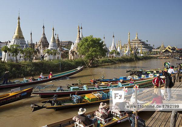 Iwama  City  Myanmar  Burma  Asia  boat  boats  canal  colourful  floating Inle  lake  skyline  stupas  touristic  tourists  transport  travel