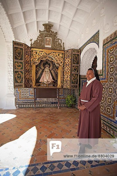 Monastery of Carmona´s St. Clare. Corner with small altar of the Cloister of the Monastery. Religious Franciscan Nuns of the order of St Clare. Carmona  Seville  Andalusia  Spain  Europe.