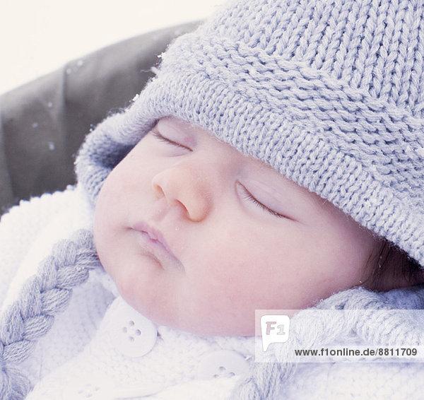 Baby sleeping  wearing knit hat  portrait