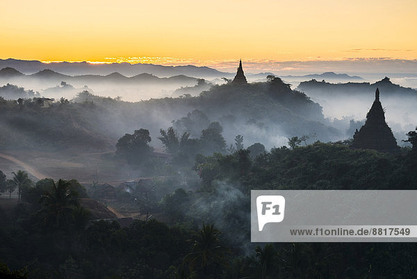 Pagodas surrounded by trees  in the mist  Mrauk U  Sittwe District  Rakhine State  Myanmar