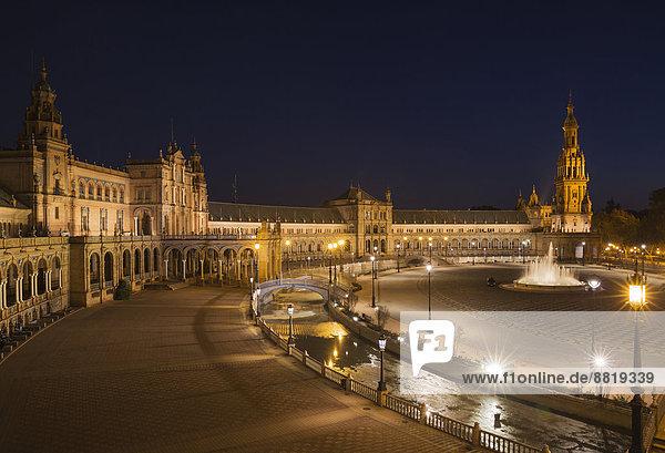 The illuminated Plaza de España at dusk  Seville  Seville province  Andalusia  Spain