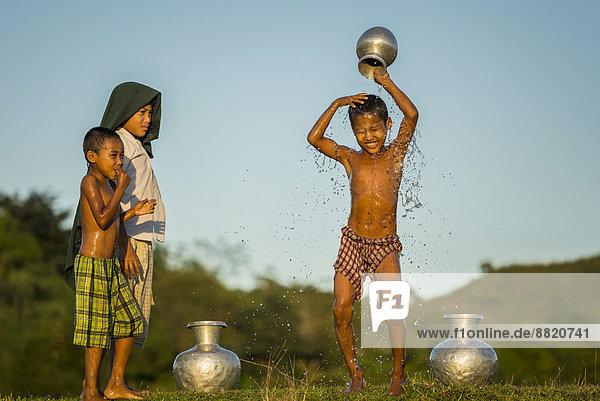 Boy washing himself  Mrauk U  Sittwe Division  Rakhine State  Myanmar