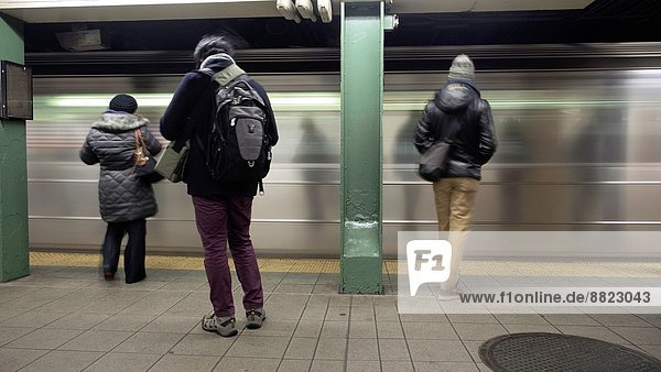 People standing on subway station platform in New York  New York.