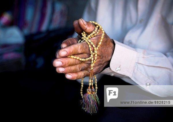 Man Praying With A Prayer Beads  Erbil  Kurdistan  Iraq.