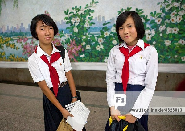 Two Young Pioneers Girls In The Subway  Pyongyang  North Korea.