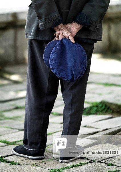 Man Holding A Blue Cap In His Back  Jianshui  Yunnan Province  China.