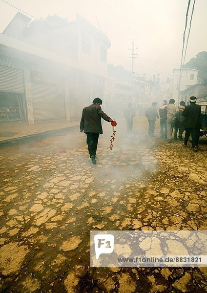 Man Holding Firecrackers During A Funeral Procession  Yuanyang  Yunnan Province  China.