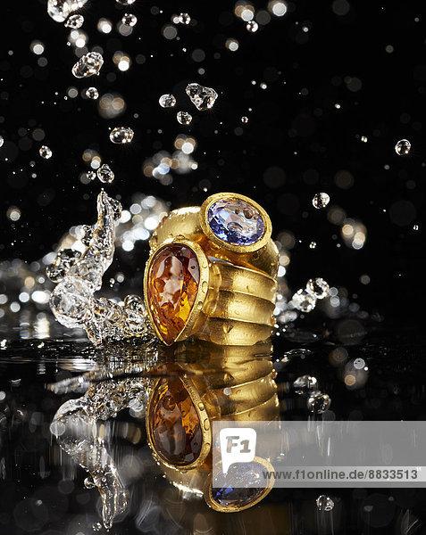 Golden ring with tanzanite and citrine  water splashing around