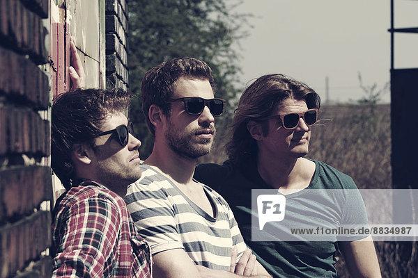 Three friends with sunglasses taking sunbath
