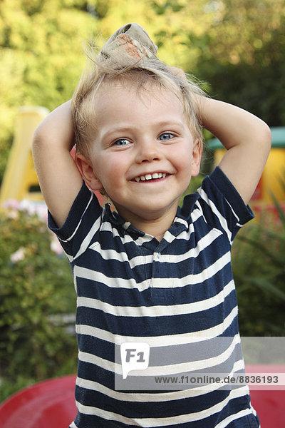 Portrait of smiling little boy with sun hat