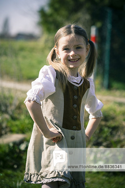 Portait of little girl posing in country style dress