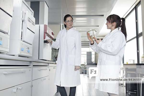 Two young female chemistry students in lab