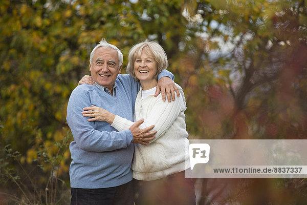 Portrait of happy senior couple hugging